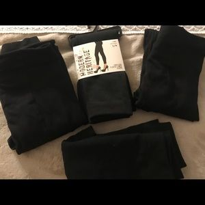 4 pairs of footless fleece lined tights in black